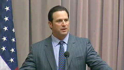 Photo shows Mike Matheny speaking about how to build great teams.