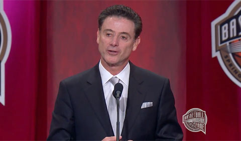 Photo shows Rick Pitino speaking at Naismith Memorial Basketball Hall of Fame induction ceremony September 9, 2013.