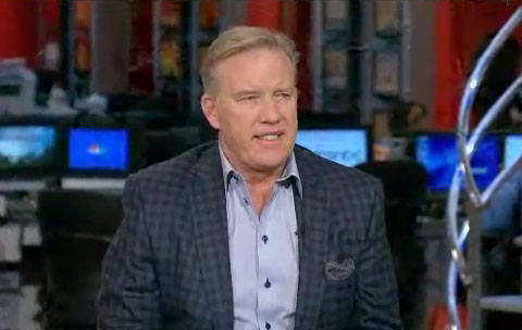 Photo shows John Elway speaking in an interview in early 2013 on the Morning Joe Show on MSNBC.