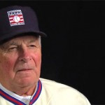 Photo shows Bobby Cox speaking in a 2013 interview with the Baseball Hall of Fame after his induction.