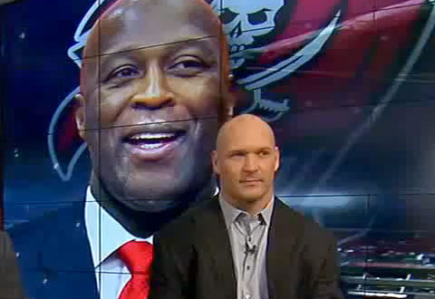 Photo shows former Chicago Bears linebacker, Brian Urlacher, with speaking with New Bucs head coach Lovie Smith on Fox Football Daily.