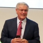 Photo shows retired NFL coach, Dick Vermeil, speaking to a group of SAP employees about his seven common sense leadership principles.