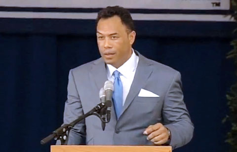 Photo shows second baseman and 12x All Star, Roberto Alomar, speaking at his Hall of Fame Induction Ceremony.