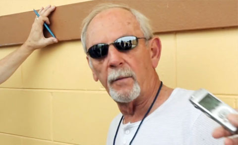 Photo shows former Detroit Tigers manager. Jim Leyland, speaking with reporters in 2014.