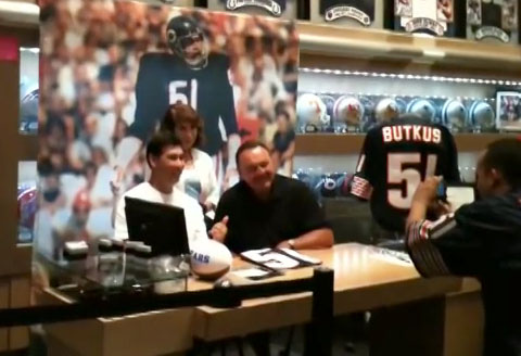 Photo shows former Bears linebacker Dick Butkus signing autographs at Caesars Palace in July 2013.